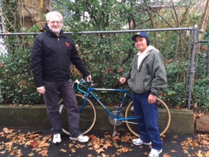 Keith Danish with bicycle recipient
