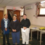 Pastor Blair and staff members Elias and Angelica announce the grant at the lunch program