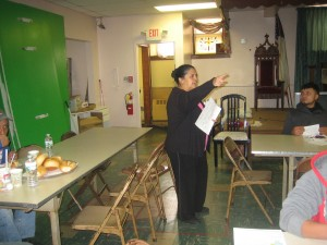 Angelica advises workers at a lunch program on wage theft issues